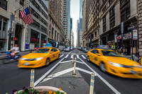 Taxis Zoom By in Downtown Manhattan